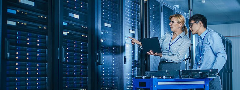 IT Network Specialists working in server room