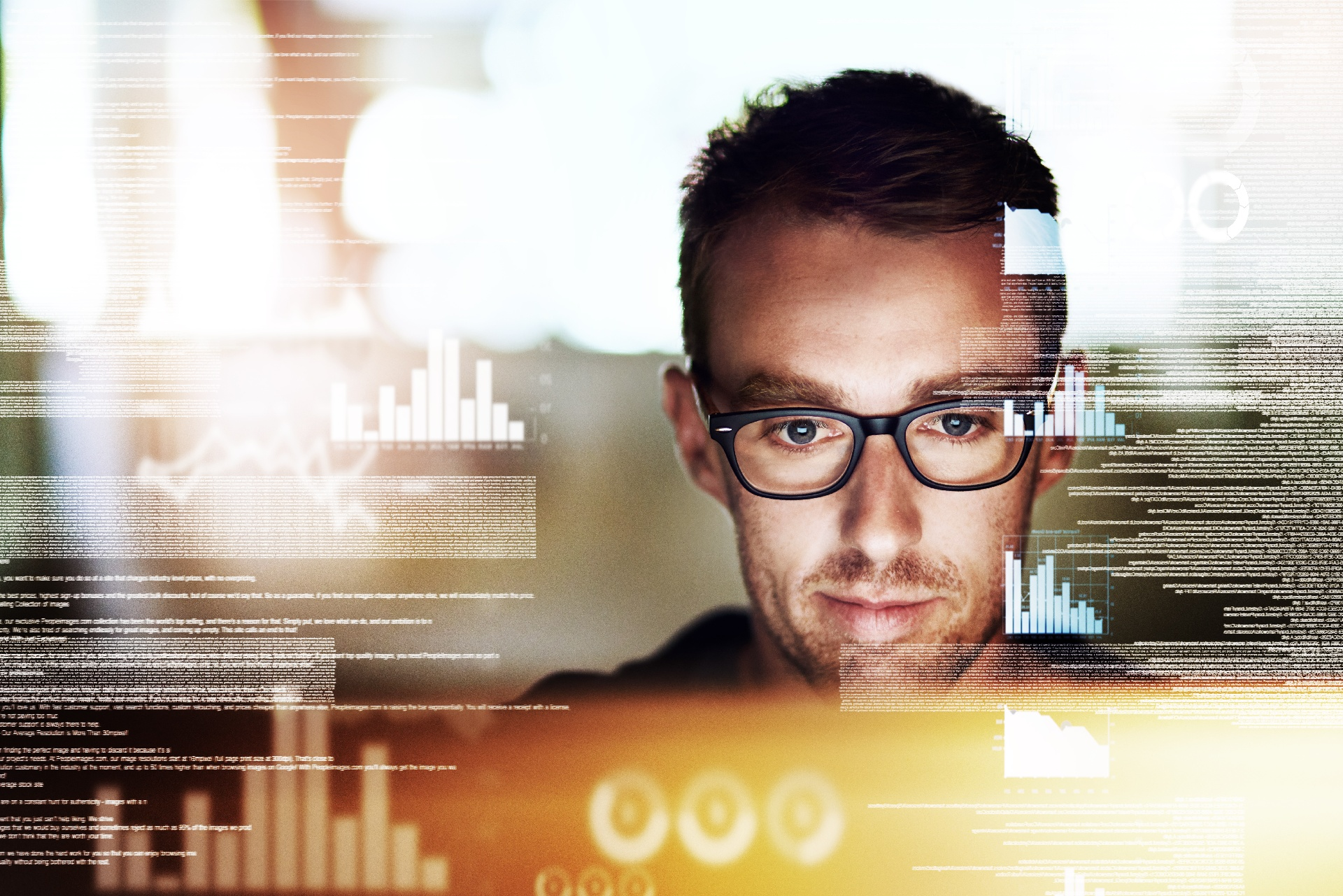 Man in glasses working in cloud computing environment
