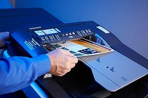 individual making color copies on a multifunction printer