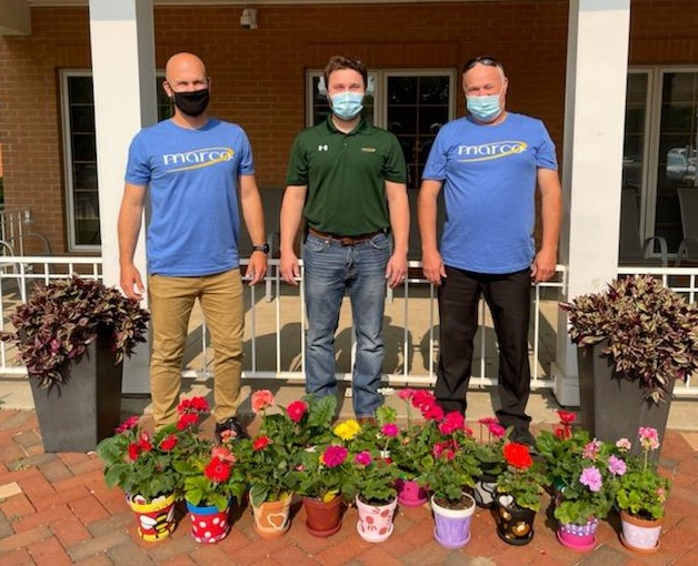 Marco employees donate painted flowerpots to senior living facilities