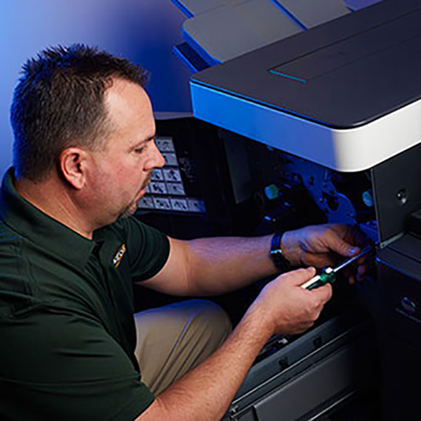 service tech working on a printer